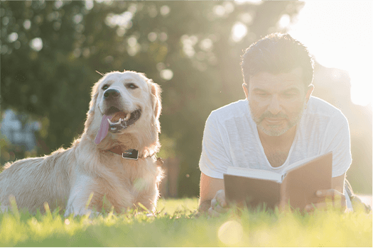 man and a dog with Pawfit pet tracker